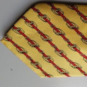 HERMES Belt Buckle Print over Yellow Background